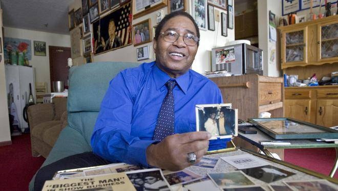 In May 2010, Billy Downey, owner of the former Arrow's Club, holds a photo himself and singer Billy Martin, an act that he says started it all for Halifax's first black club, which ran from 1962-1979. Funeral services for Downey, who died last week will be held Saturday. (TIM KROCHAK / Staff)